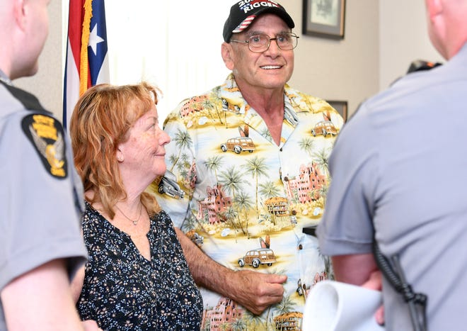 Phyllis and Robert Smith receive the Saved by the Belt award at Ohio Highway Patrol's Canton post.