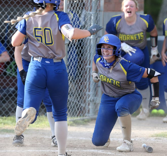 East Canton's Marisa Hall welcomes teammate Kaley Steigerwald to home plate after Steigerwald's two-run home run gave the Hornets the lead in Wednesday's Division IV district final against McDonald.