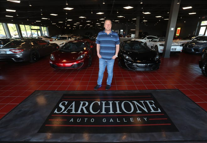 Ryan Burton, a managing partner of Sarchione Auto Gallery, is pictured Thursday inside the auto shop, which opened in early May at 4643 Everhard Road NW in Jackson Township. The gallery – housed at the former Pier 1 Imports store – features multiple types of exotic sports cars and vehicles.