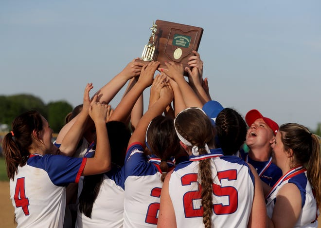 Tuslaw raises the Division III district final trophy after defeating Black River at Norwayne High School.