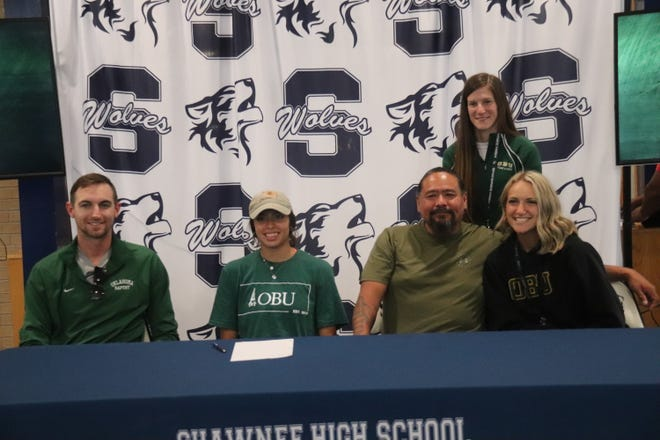 Seated with Kailey Henry (second from left) are personal coach Trevor Mastin (far left), Kailey's father Ross Henry and Shawnee assistant track coach Leah Molter. Standing is Shawnee girls' head track coach Sara Branson.