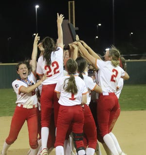 The Dale Lady Pirates hoist their Class 4A state slow pitch championship trophy on May 5.