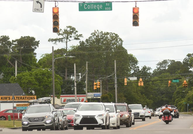 Traffic moves through the intersection of South College Road and Wilshire Boulevard in Wilmington.