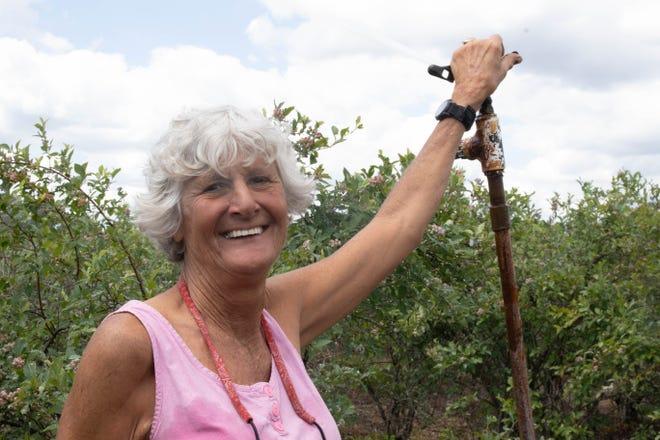 Debbie Gustafson of Nelson Blueberries stands in her field.