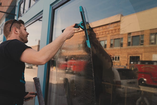 Ethan Westby cleans windows in Aberdeen for his business TripleC Window Cleaning. The business has been around for four years.