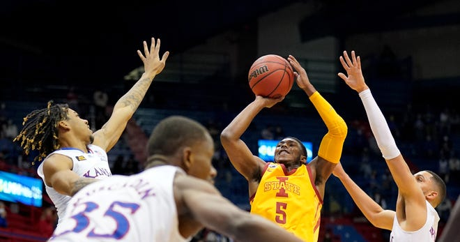 Former Iowa State guard Jalen Coleman-Lands attempts a shot during a contest against Kansas last season at Allen Fieldhouse in Lawrence. Coleman-Lands on Wednesday announced his intention to transfer into the Jayhawks this offseason.
