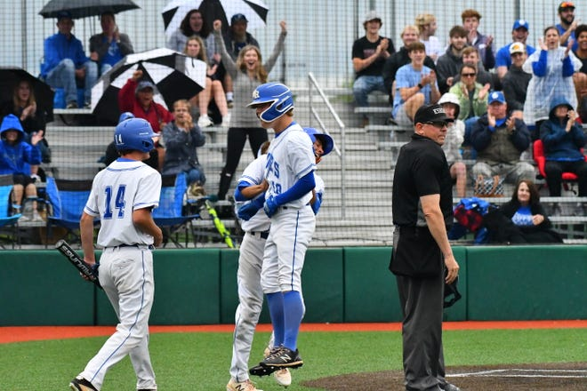 Washburn Rural's Hunter Vondemkamp celebrates after scoring on an inside-the-park home run during Wednesday's Class 6A regional semifinal win over Wichita Heights at Bettis Family Sports Complex. Rural won 8-0 and was trailing Dodge City 2-1 in the title game when it was postponed until Friday.
