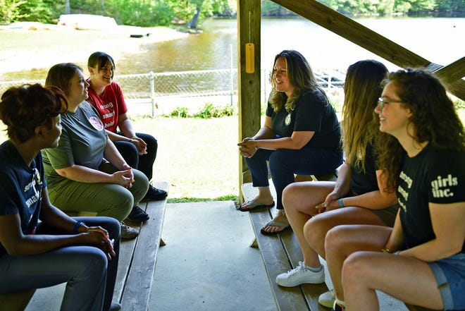 Girls Inc. operating manager Allison James, third from right, speaks with staff at the camp Thursday in Holden.