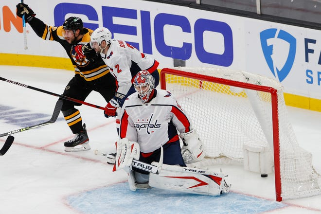 After stealing the puck from Capitals defenseman Justin Schultz (2), Bruins right wing Craig Smith (12) celebrates his winning goal on goaltender Ilya Samsonov (30) during the second overtime of Game 3 at TD Garden.