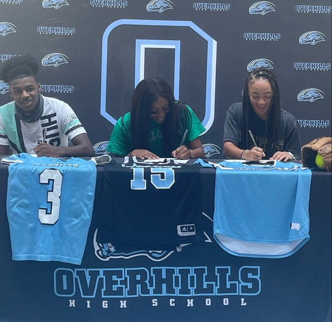 Overhills athletes Chris Perkins (3), Ariel Gamble and Maaika Dones celebrated their college choices Friday with a signing ceremony.