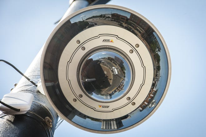 Looking straight up at the surveillance camera on the west side of Gillespie Street at the Market House.