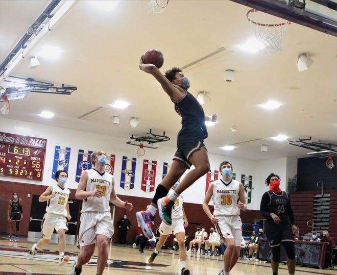 Menomonee Falls guard Seth Trimble throws down a dunk against Marquette during a game on Dec. 2, 2020.