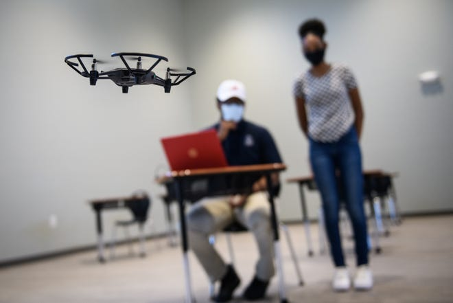 High school students, Marcus Bell and Alanah Justice-Purcell show off what they learned in a new drone class at Alpha Academy.