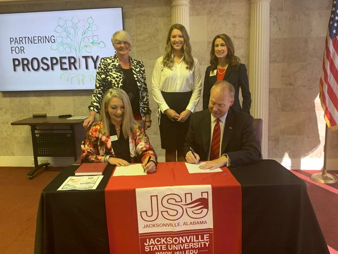 The Chamber of Gadsden & Etowah County on Thursday announced that it will be partnering with Jacksonville State University to offer a 20% tuition discount to Chamber members and their employees, beginning in Fall 2021. Signing the agreement are, seated, Morgan Lavender of Modern Woodmen and current board chair for The Chamber and Dr. Don Killingsworth, JSU president. Looking on are, from left, Heather New, president and CEO of The Chamber; Lauren Findley, JSU enrollment specialist; and Dr. Emily Messer, vice president for enrollment management.