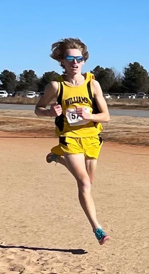 Williams High School runner Ryan Motondo races at the NCHSAA Class 3-A state championships for cross country in January. Motondo won the race to become a state champion.
