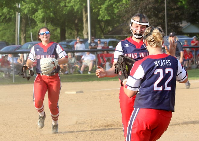 Indian Valley pitcher Mia Rose, first baseman Madison Monte and third baseman Tracey Zurfley celebrate the win over Dover in the  Division II District championship game at Strasburg Wednesday.