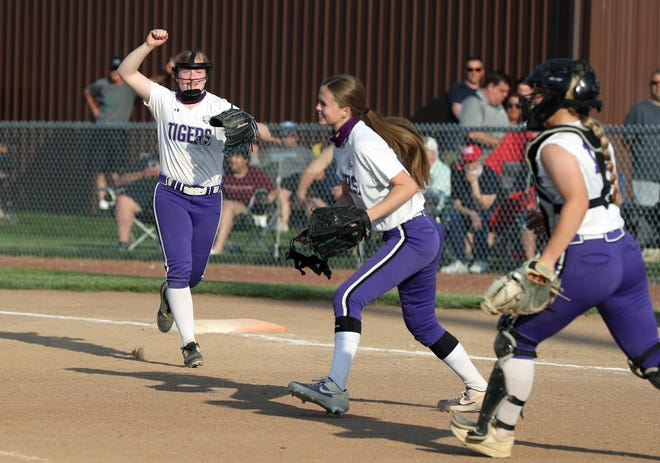 Pickerington Central's Lilli Burns (left), Makenzie O'Neil and Ellie Tressler celebrate after the final out in a 5-2 win over host Hilliard Darby in a Division I district final May 19.