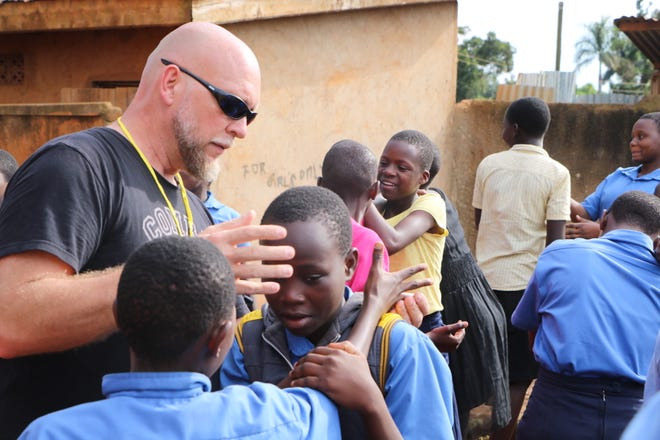 As part of their effort to help develop defense skills in others, Rich and Barrett Ohm have traveled to Uganda to teach children how to defend themselves from violence.