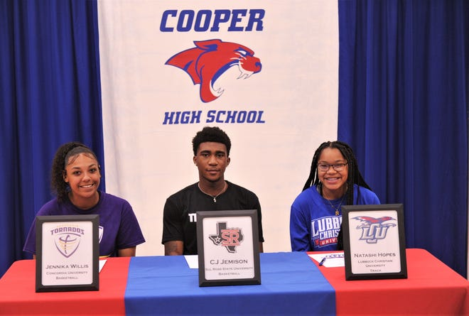 Cooper's Jennika Willis, left, C.J. Jemison, center, and Natashi Hopes were part of a college signing ceremony Wednesday at Cougar Gym. Willis will play basketball at Concordia in Austin, while Jemison play basketball at Sul Ross State in Alpine. Hopes will run track at Lubbock Christian.