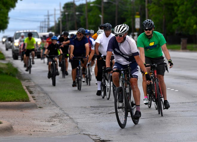 Bicyclists make the turn at South 27th Street and Barrow streets Wednesday during the Ride of Silence.