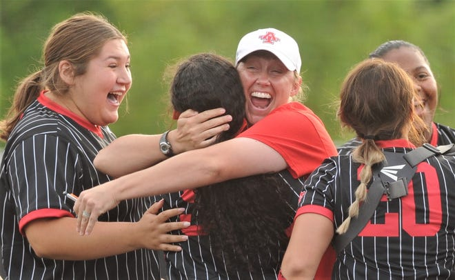 Anson coach Kym Chapa hugs pitcher Valerie Fells after Fells coaxed the final out in the Lady Tigers' 10-9 victory over Colorado City in the opener of the best-of-three Region I-2A semifinal series Wednesday at ACU's Poly Wells Field.