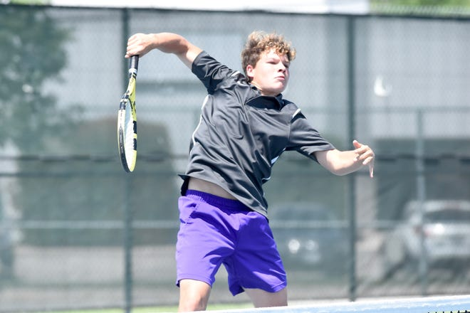Mason's Bailan Kerr follows through on a shot at the net during Thursday's Class 2A boys doubles semifinal of the UIL state championships at the Blossom Tennis Center in San Antonio on May 20, 2021.