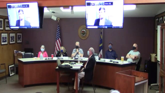 The Woodfin Zoning Board of Adjustment meets April 5. As of May 18, the Woodfin Town Board of Commissioners has disbanded the board and created two separate boards, a zoning board and a board of adjustment.
