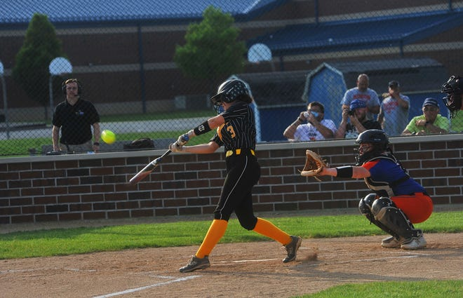 Colonel Crawford's Harley Thomas fouls a ball off the Edison pitcher in a district semifinal.