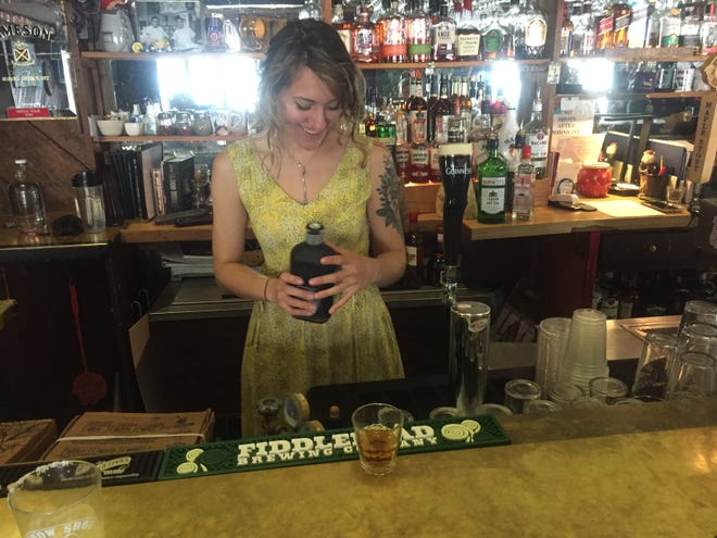 Nikki Woods pours a drink May 13, 2021 at the Snow Shoe Lodge & Pub in Montgomery Center.