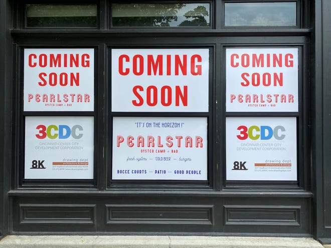 Signs for the new Pearstar oyster bar in OTR