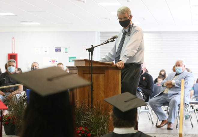 Superintedant Richard Raach addresses the graduates of the Coshocton County Career Center at the recent passport ceremony. Raach will retire from the position this summer.