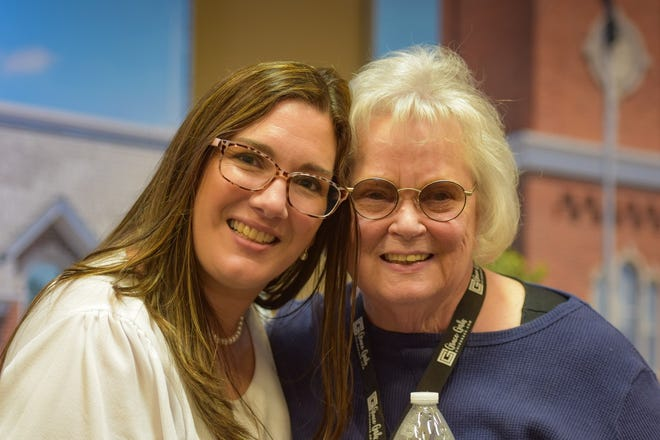 Speaker and author Cassia Elder, left, is often embraced by her fans following speaking engagements. Here, she connects with Marveen Fasnacht of Clyde.