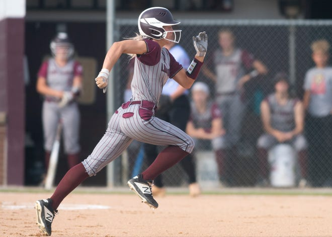 Henderson County's Kaytlan Kemp (1) tries to steal second as the Lady Colonels play Union County on May 19 in Henderson.