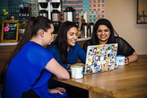 Salesforce employees enjoy a wellbeing break in the social lounge.