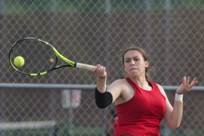 West Lafayette's Leandra Suter hits the ball during an IHSAA sectional tennis doubles match, Wednesday, May 19, 2021 in West Lafayette.