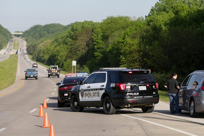 Lafayette Police Department work the scene of a crash after a pedestrian was struck and killed along Sagamore Parkway near Duncan Road, Thursday, May 20, 2021 in Lafayette.