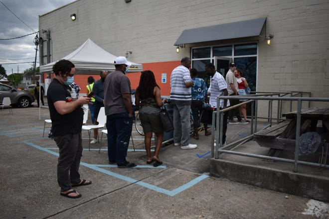 People line up to get vaccinated at a pop-up vaccine event at the Propeller business incubator in New Orleans.