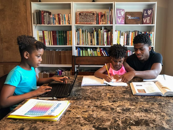 Jadon, Mariah and Monae Johnson of Lafayette complete their school work together. They homeschool and incorporate family devotionals into their day.