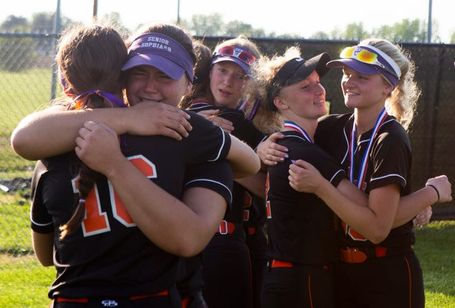 Amanda-Clearcreek's hug one another after losing the Division III District Championship against Johnstown in varsity softball action at Amanda-Clearcreek High School in Amanda, Ohio on May 19, 2021.