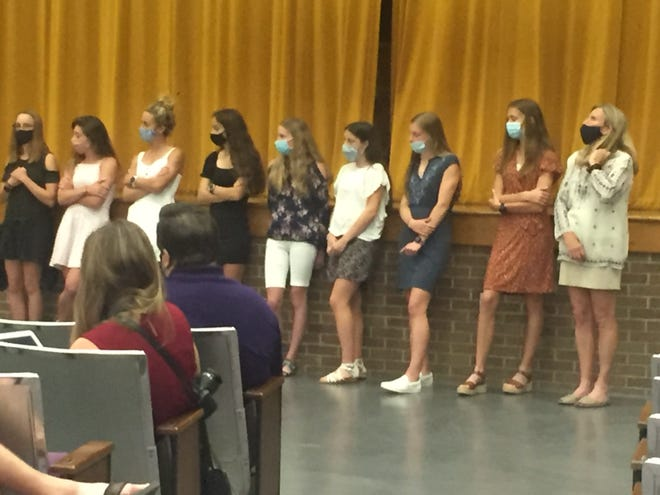 Members of the state champion girls cross country team were recognized at Wednesday's Lexington school board meeting.