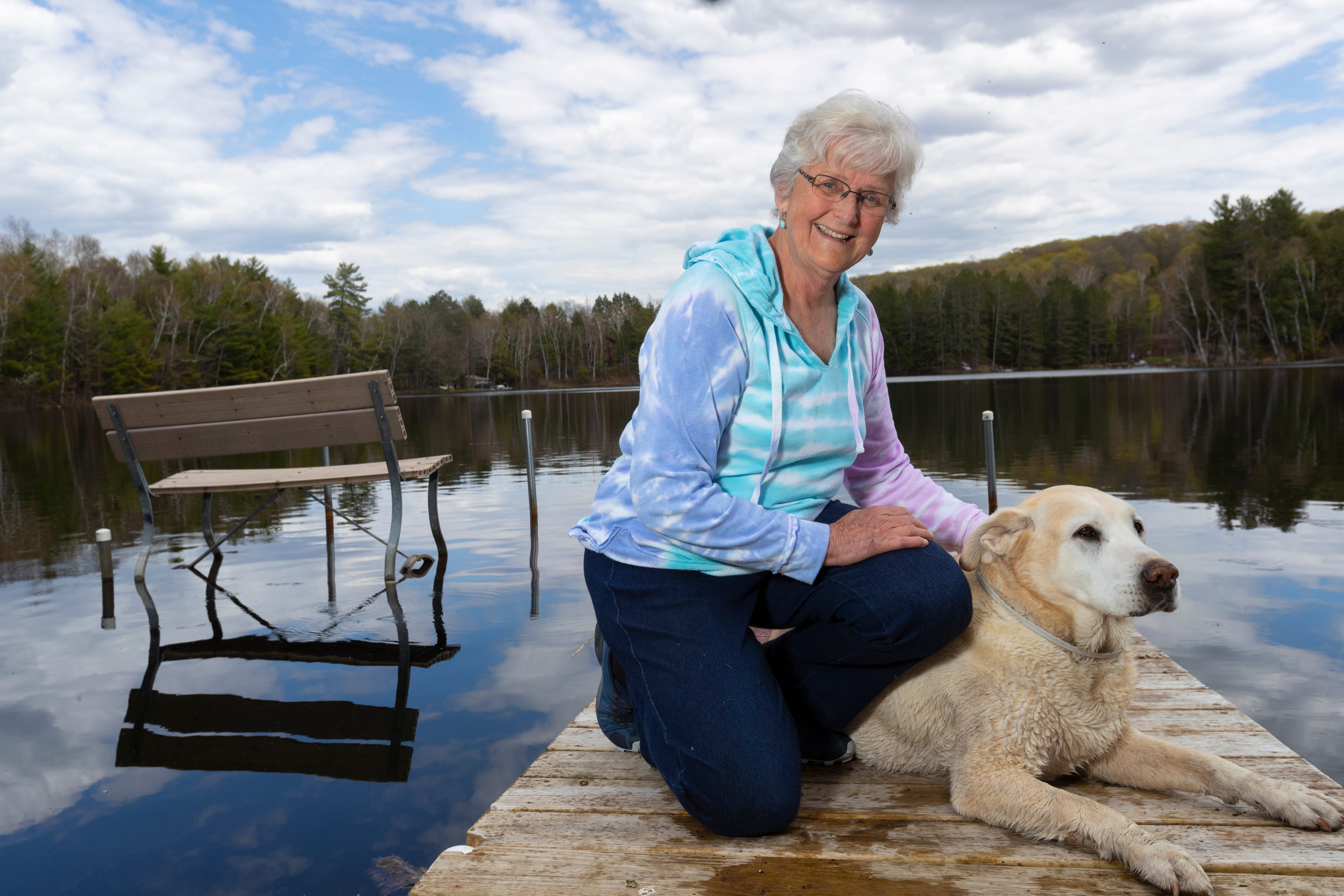 Patricia Voermans with her dog, Tucker, on her dock at her home on Lake Buteau in Gleason. Voermans said broadband always seems just out of reach.
