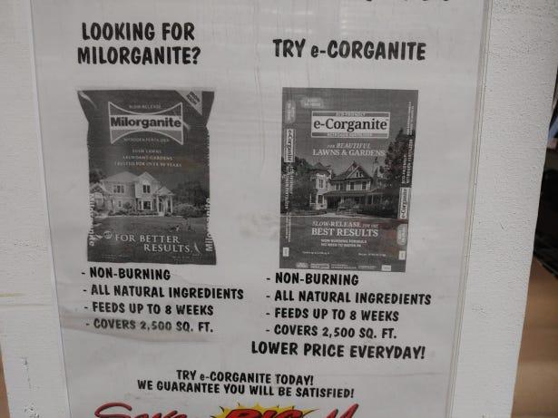 A Menards store display shows the similarities between its e-Corganite fertilizer and Milorganite fertilizer.