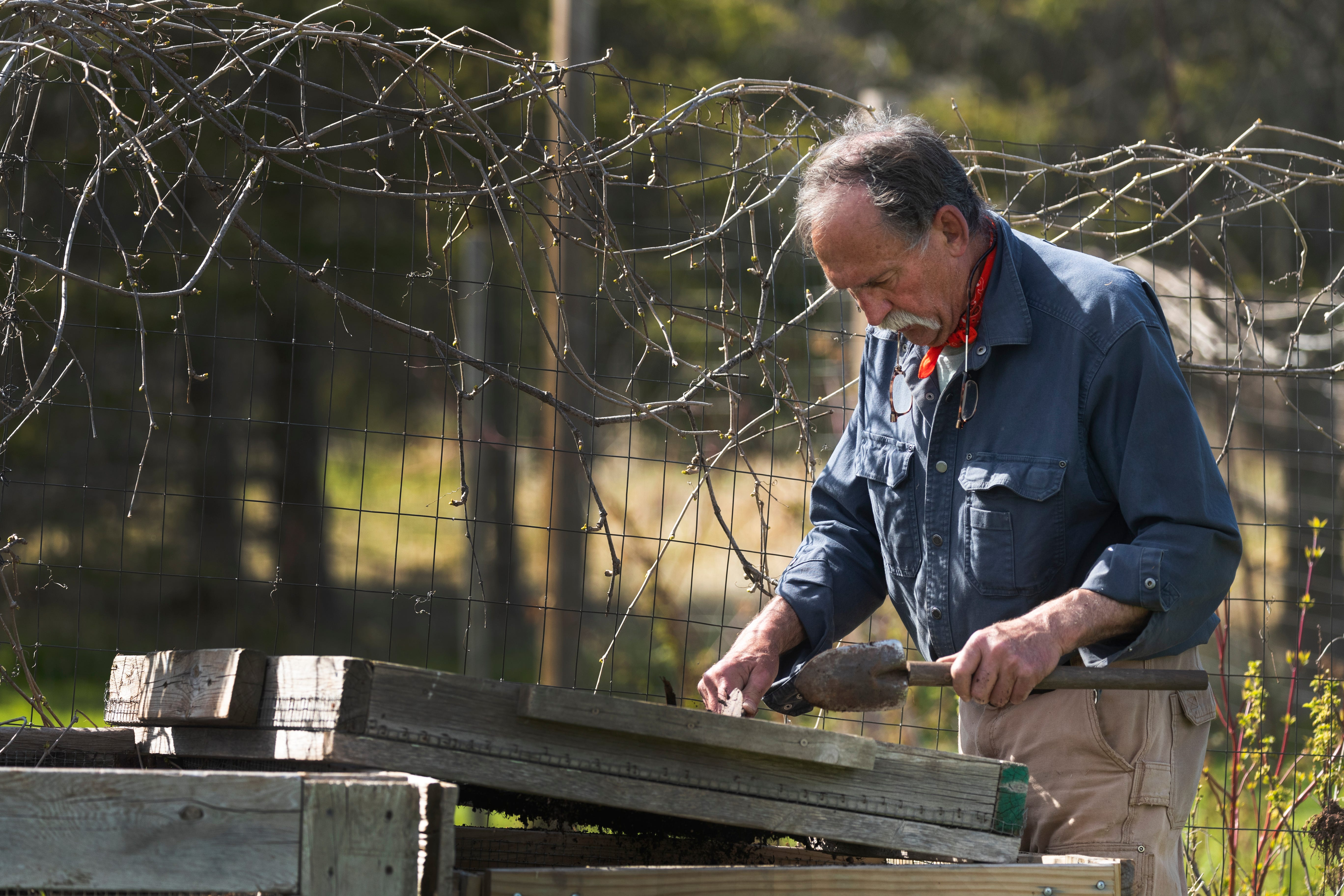 Michael Spencer tends to his garden at his home in the Town of Cloverland in Douglas County. He spearheaded the campaign to subsidize the cost of bringing fiber-optic cable to the area.