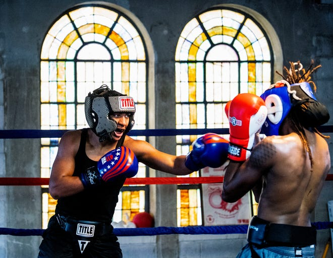 Ellian Harris, left, spars with Marcus Thomas at Faith Boxing in Montgomery, Ala., on Tuesday May 11, 2021.
