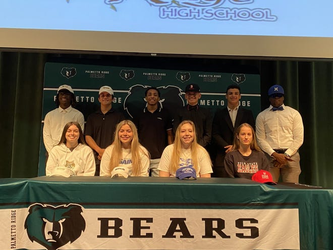 Palmetto Ridge High School held a signing ceremony on Wednesday, May 19, 2021 for its student-athletes going to play sports in college. They are: (sitting, left to right) Destiny Boaz, softball, East Georgia State College;  Kaylie Araujo, softball, Sante Fe College; Katie Mollberg, volleyball, Colby Sawyer College;  Emma Laupert, soccer, Polk State College; (standing, left to right) Jayquan Louis, football, Warner University;  Gabe Seifert, football, University of Wisconsin–Oshkosh;  Jacob Dumas, wrestling, Montreat College; Evan Rodriguez, football, Benedictine University; Tony Petraglia, wrestling, Montreat College; Fabien Pierre, football, Illinois College