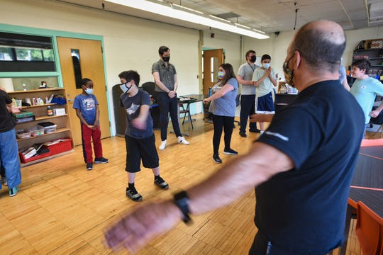 Physical Educational Teacher Larry Goodman leads students with disabilities during a yoga class in the LEAP Program at West Brook Middle School in Paramus on 5/20/21.
