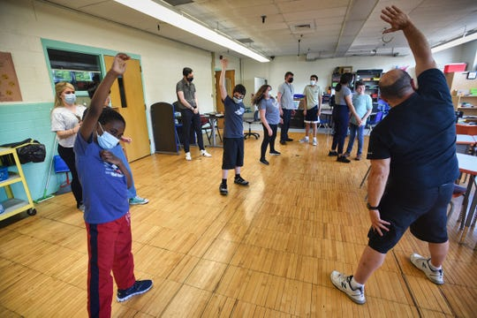 Physical Educational Teacher Larry Goodman leads students with special needs during a yoga class in LEAP Program at West Brook Middle School in Paramus on 05/20/21.