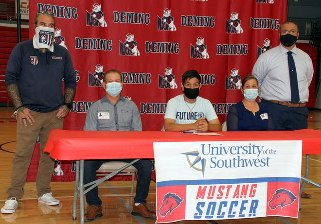 Deming High graduate Jerry Gutierrez (center) signed on to attend and play soccer at the University of the Southwest in Hobbs, NM. Joining Jerry for the signing on Wednesday were, from left, DHS Coach Jesse Kriegel, parents Leo Gutierrez and Dolores Gutierrez, and DHS Athletic/Activities Director Bernie Chavez.