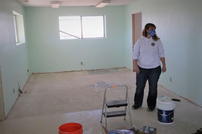 Denkai New Mexico founder Floss Blackburn stands in what will serve as the reception area of the organization's planned animal shelter in the old Halliburton building on the Bloomfield Highway on April 16, 2021.
