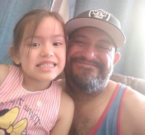 Karyn and Robert Gonzalez Jr. posing for a selfie.